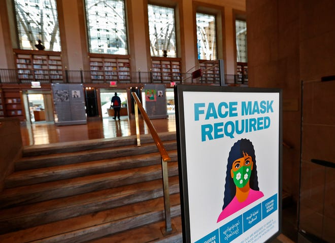 A sign greets visitors Wednesday, Sept. 8, 2021 at the Central Library of the Indianapolis Public Library. Masks are now required in the library.