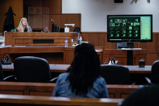 Judge Anne Delahanty, left, moves through eviction court cases, the majority via Zoom, in room 308 of the Jefferson County Judicial Center. Sept. 1, 2021