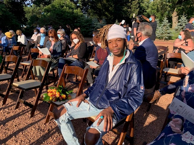 Tyrone Randle waits for the start of the memorial service and unveiling of the grave marker for lynching victim George Marshall Clark Wednesday at Forest Home Cemetery. Randle led the effort to raise money for the gravestone.