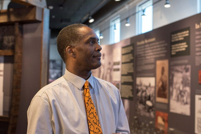 Reggie Jackson, a former oral historian and board member of America's Black Holocaust Museum in Milwaukee, in the museum's gallery. Jackson says two of his uncles who served in World War II were unable to benefit from the GI Bill in their home state of Mississippi because they were Black. This made it difficult for generations that came afterward to acquire wealth and catch up to the white servicemen who had access to benefits, including free college tuition and help buying a home.
