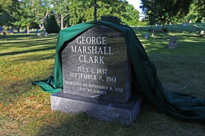 After 160 years, the unmarked grave of George Marshall Clark has a granite headstone. It was unveiled Wednesday at Forest Home Cemetery. Clark's death on Sept. 8, 1861, is the only recorded lynching in Milwaukee.