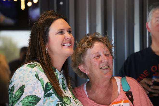 Sarah Huckabee Sanders snaps a photo with members of the crowd at Buncle's Brick Oven & Brew in Mountain Home. Sander's is currently running in the Republican primary for governor against Arkansas Attorney General Leslie Rutledge.