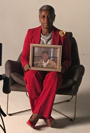 Carolyn Tyus holds a photo of her son, Renota Tyus, who was killed by a drunk driver in 2008.