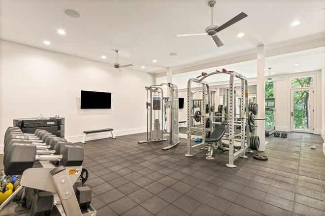 This custom home by Grove Park Construction shows the level of commitment some homeowners are going to for their home gym experience. Notice the gym flooring, direct access to the outdoors and ample room for weight racks and additional fitness equipment.