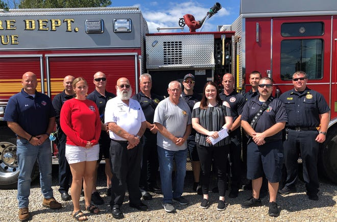 Ed Roberts (front, second from left), Licking County Shrine Club president, recently presented county fire departments and emergency medical squads with thermal imaging cameras, and checks totaling thousands of dollars.
