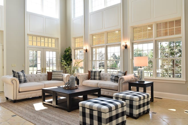 This home is staged as clutter-free to better show off the space's clean lines and ample light. Staging can help speed up a sale of a house being flipped.