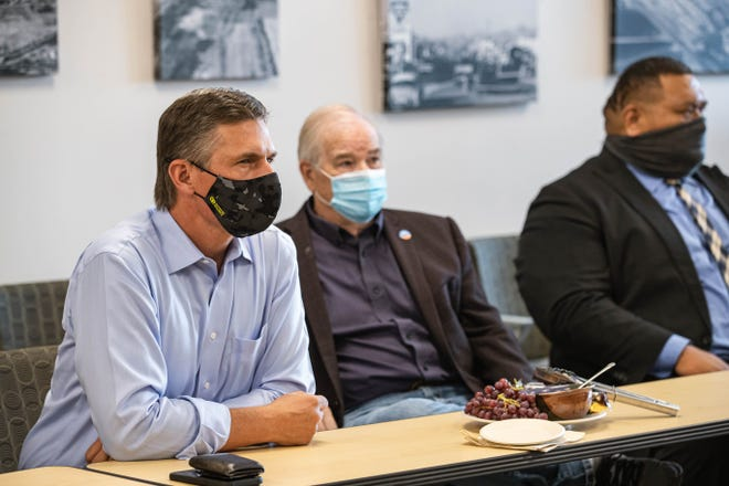 Sen. Martin Heinrich,  left, with City Council Gill Sorg, center, and City Manager Ifo Pili, visits Las Cruces City Hall on Wednesday, Sept. 8, 2021, to discuss the city's renewable energy and emissions-reduction initiatives