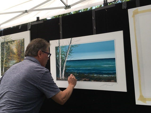 An unexpected sight of an artist painting in his booth  fascinated viewers. Thomas LeGault added beautiful finishing touches to his landscapes.