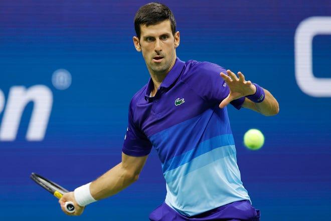 Novak Djokovic returns the ball against Holger Vitus Nodskov Rune of Denmark on Day Two of the 2021 US Open at the Billie Jean King National Tennis Center on August 31, 2021 New York City.