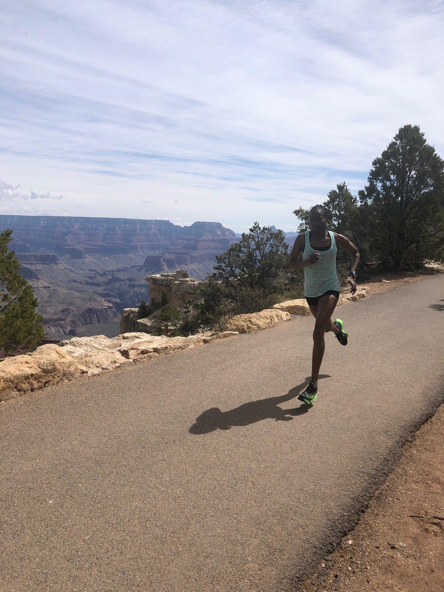 Janet Cherobon-Bawcom runs along the Grand Canyon's South Rim.