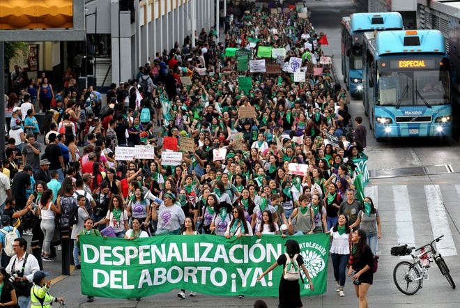 Activists supporting the decriminalization of abortion in Mexico march in Guadalajara, Mexico, on September 28, 2019, during activities in the framework of the International Safe Abortion Day.