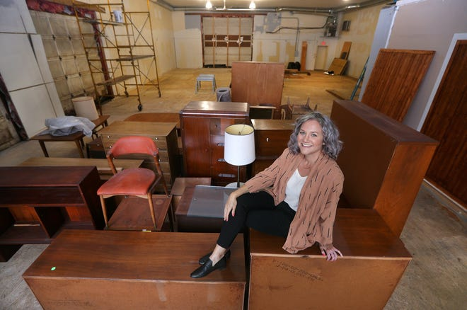 Abode store owner Ariane Krenichyn with some of the home decor and furnishings she is moving into her new location in Northfield Common in Pittsford.