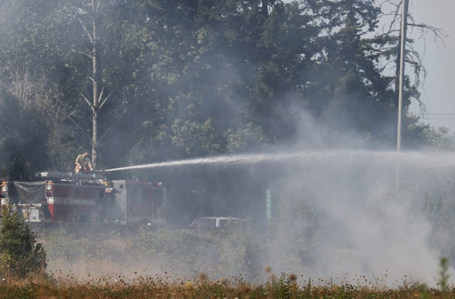 Crews tamped down a grass fire near I-5 and Portland Road on Wednesday, Sept. 8, 2021.