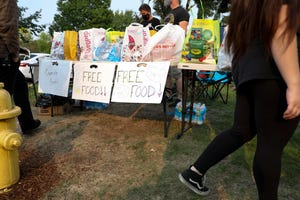 Community members hosted a mutual aid event offering free food, hygiene products, school supplies and reproductive health information outside Planned Parenthood in Salem on Tuesday.