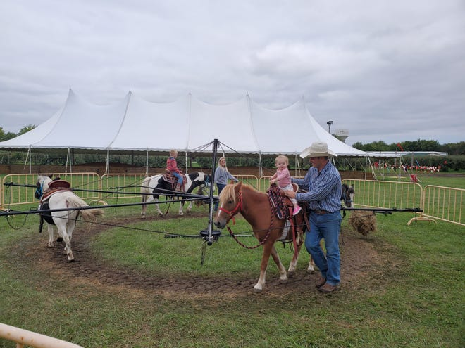 Children take part in pony rides at the Country Apple Orchard.