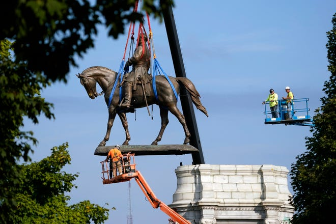 The statue of Confederate Gen. Robert E. Lee in Richmond, Va., is taken down on Wednesday, Sept. 8, 2021, more than 130 years after it was erected.