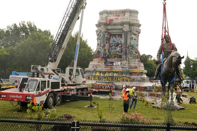 Crews remove one of the country's largest remaining monuments to the Confederacy, a towering statue of Confederate General Robert E. Lee on Monument Avenue in Richmond, Va., Wednesday, Sept. 8, 2021.