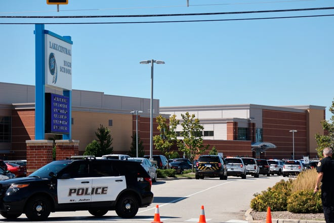 Police rush to Lake Central High School after a report of an active shooter Wednesday morning, Sept. 8, 2021 in St. John, Ind. No shots were fired, according to school officials.
