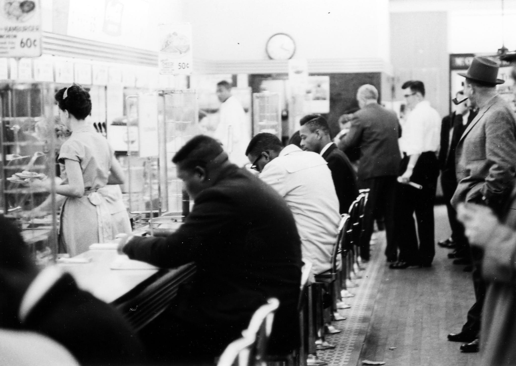 """In this February 1960 file photo, people take part in a civil rights """"sit-in"""" protest at the lunch counter in McCrory's Five & Dime in Rock Hill, S.C."""