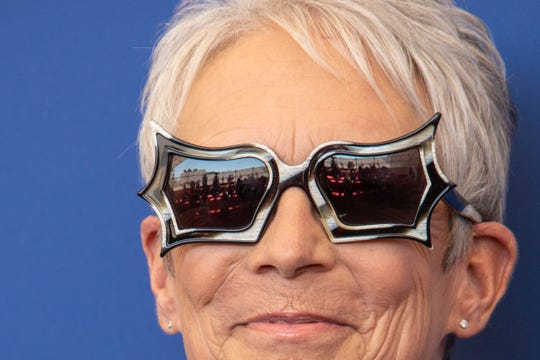 Sept. 8, 2021: Jamie Lee Curtis poses for photographers, reflected in glasses, at the photo call for the film 'Halloween Kills' during the 78th edition of the Venice Film Festival in Venice, Italy.
