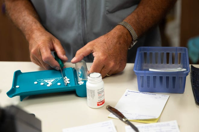 A pharmacist is shown filling prescriptions in 2018. Pharmacists and doctors are sorting out what Texas' new abortion restrictions mean for them, given the fact that a drug prescribed for miscarriages and other problems can also be used as part of a medication abortion.
