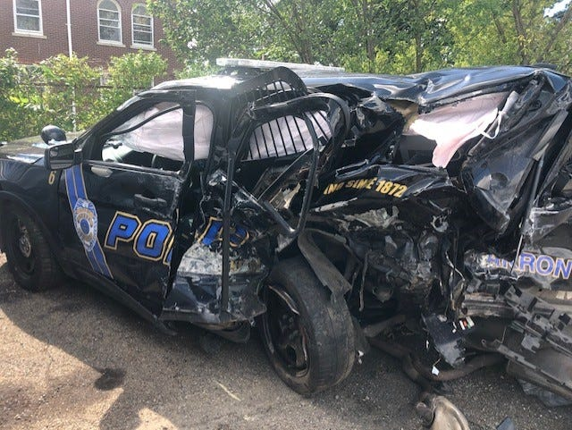 An Akron police cruiser was struck Saturday by a Hyundai Sonata. Four officers and the driver of the Sonata were injured.