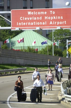 Passengers walk out to the terminal area at Cleveland Hopkins International Airport Sept. 11, 2001, after the airport closed  due to the terrorist attacks in New York and Washington.