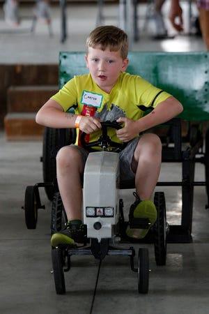 Carter Carpenter competes in the kiddie pedal pull Sunday, Sept. 15, 2019 at the Ashland County Fair. Tom E. Puskar, Times-Gazette.com