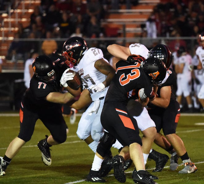 """Kyler Hall (77) and the rest of the Ames defense must step it up a notch if the Little Cyclones hope to upset an Iowa City High team averaging 54.5 points in the """"Little Cy-Hawk"""" football game Friday at Ames."""