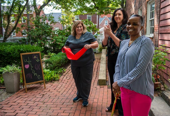 Valerie Pedigo, center, and the Ambridge Regional Chamber of Commerce hosted a ribbon cutting ceremony for Jessica Patrick, right, owner of the Hands On Health and Wellness Spa on Church Street Thursday.  This was the first in-person event the Chamber has held since the pandemic hit. [Lucy Schaly/For BCT]