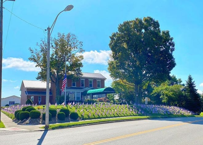 Campbell-Plumly-Milburn Funeral Home & Cremation Services placed 415 American flags in their yard -- one for each first responder that died on Sept. 11th.