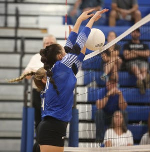 Boonville junior Madison Smith goes up for a block in the second set against Centralia Tuesday night in the Lady Pirates home opener  at the Windsor gymnasium. The Lady Pirates defeated Centralia in four sets to improve to 2-1 on the season.