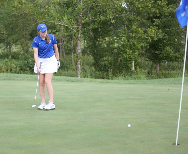 Boonville junior golfer Katelyn Smith sinks this putt on the No. 12 green Tuesday in a triangular meet against California and Sedalia Sacred Heart and Hail Ridge Golf Course in Boonville.