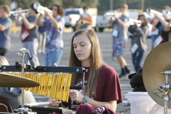 Brownwood High School senior Caroline Burcham plays the wind chimes as the Lions band practices Thursday morning under the direction of David Lambert.
