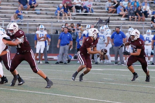 Brownwood's Chance Jones (6) prepares to handoff to Konlyn Anderson (2) while Taylor Bessent (27) blocks in the Lions' 58-55 season-opening win over Lampasas on Friday, Aug. 27, 2021.
