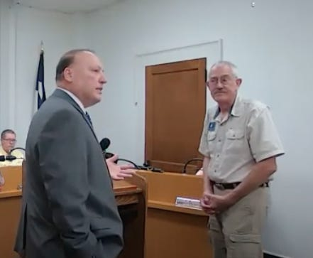Brown County Judge Paul Lilly speaks with James Masters at the Commissioners Court meeting Tuesday morning.