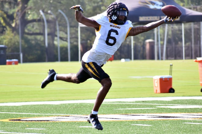 Missouri wide receiver Keke Chism (6) stretches with his left hand to catch a pass during a pracice on Tuesday at the Kadlec Practice Fields.