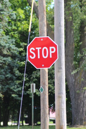 The stop sign for eastbound traffic on Division Street in the City of Cheboygan at the intersection of Dresser Street has been replaced by the city and is included on the list provided to the council members.