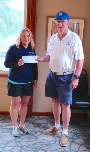 Penn Yan Lions Club member Jim Carey presents Dawn Shipman, Yates Community Center manager, with a check for $5,000 to support youth programs at the Yates Community Center.