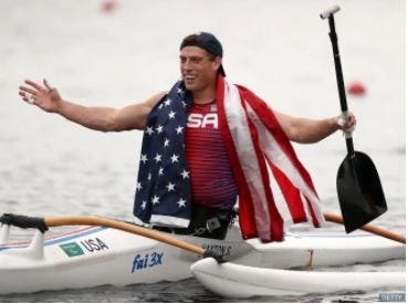 Blake Haxton celebrates his silver medal performance in the 200-meter canoe race at the Paralympic Games in Tokyo.