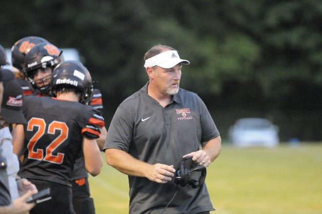 Hudson head coach Dan Rogers walks the sideline during the Week 1 game against Ithaca.