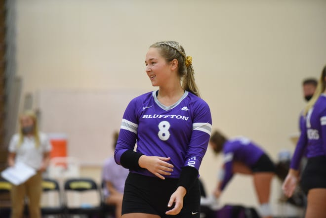 Bluffton defensive specialist and Madison High School graduate Kia Rainey smiles during a match against Adrian College on Wednesday. [Telegram photo by Deloris Clark-Osborne]