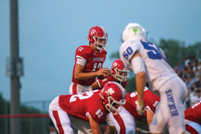 Huston Halverson waits for the snap during a game against Bondurant-Farrar on Friday, Sept. 3 in Grimes.