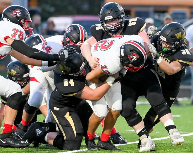 Western Wayne's defense utterly stymied a potent North Pocono attack in Week Three of LFC action. Pictured here stuffing a Trojan ballcarrier are: Thomas Flood (64), Kyle Guarino (52) and Carter Mistishin (32).