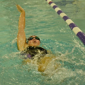 West Canada Valley Indian Maya Farber races to a victory in the 100-yard backstroke during Tuesday's meet against Holland Patent.