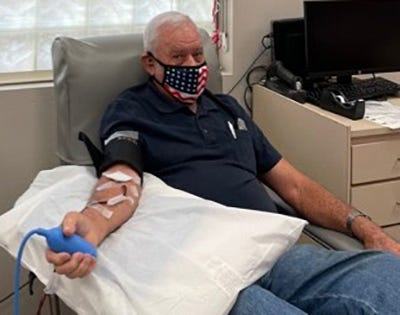 Tolly Strickland makes a blood platelet donation at OneBlood's Donor Center on Beach Boulevard. He has been donating blood since 1965 and recently reached the 100-gallon milestone.