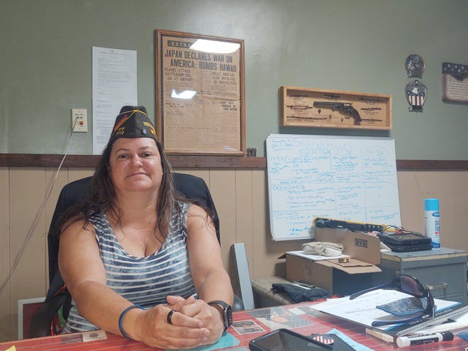 Penny Poolaw sits in her office at the Sherman VFW Post 2772. Poolaw served in the Army National Guard and was deployed to Iraq in 2007.