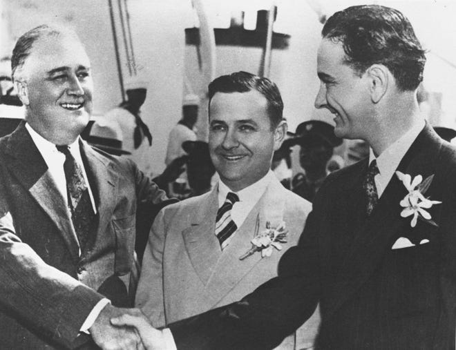 """FDR shakes hands with young LBJ, Gov. Allred of Texas in between. Galveston, Texas on May 12, 1937."""" President Roosevelt, Governor James Allred of Texas, and Johnson. In later campaigns, Johnson edited Governor Allred out of the picture to assist his campaign"""