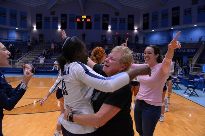 Lauren Mims and Dorman volleyball coach Paula Kirkland embrace after the Cavaliers swept Mauldin on Sept. 8, 2021. The win was Kirkland's 1000th career victory, making her only the second coach in South Carolina history to reach the milestone.