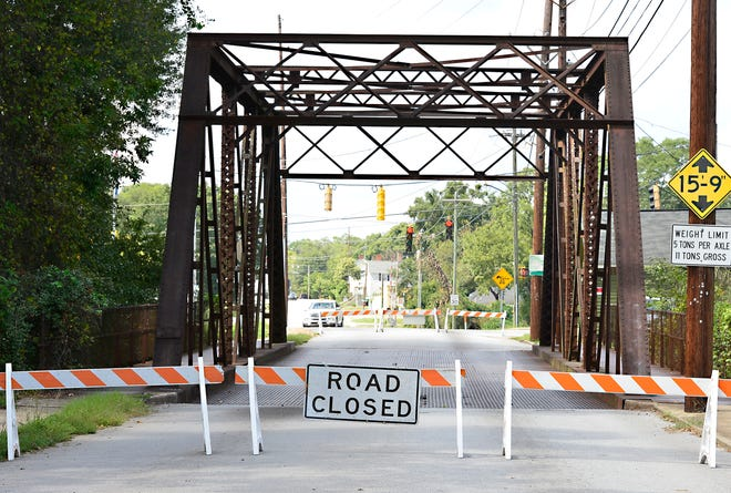 A 108-year-old steel truss bridge in Spartanburg's north side is closed temporarily for decking repair, a city official said Thursday. Barricades were installed Sunday at the North Forest Street overpass after a part of metal decking was found to be loose, creating a 2-inch gap, said Jay Squires, the city's streets and stormwater manager.